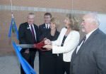 Dignitaries cut a ribbon which launched a champagne bottle to christen the new Algoma Central Corporation Marine Emergency Duties (MED) Centre at the Owen Sound Campus of Georgian College on Thursday, 倍频程6,2016. Participants are, from left, Eric McKenzie, Vice President, Technical 服务, Lower Lakes Towing; MaryLynn West-Moynes, President and CEO, Georgian College; Karen Watt, Vice President Human Resources, Algoma Central Corporation; Bill Walker, Bruce-Grey-欧文的声音 MPP; and Alan Barfoot, Grey County Warden. (Georgian College handout/Doug Crawford)